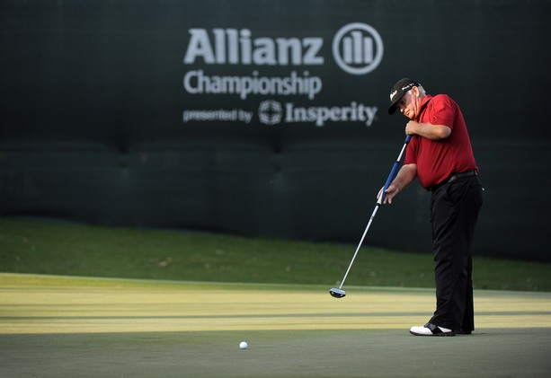 BOCA RATON, FL - FEBRUARY 11: Peter Senior watches his putt on the 18th green during the second round of the Allianz Championship at The Old Course at Broken Sound on February 11, 2012 in Boca Raton, Florida.