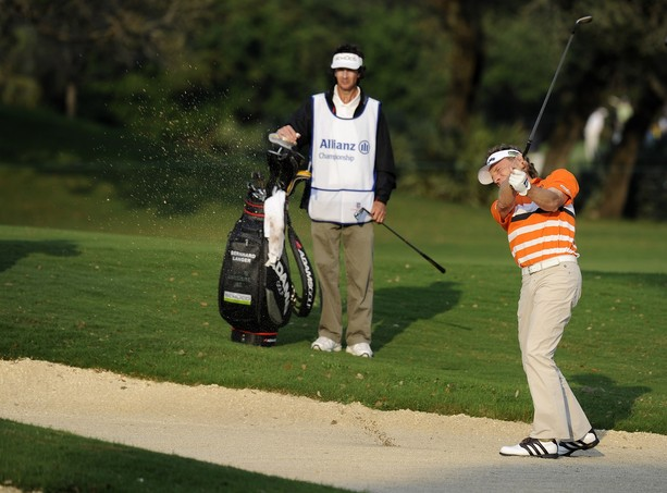 BOCA RATON, FL - FEBRUARY 11: Bernhard Langer hits to the 18th green from a bunker during the second round of the Allianz Championship at The Old Course at Broken Sound on February 11, 2012 in Boca Raton, Florida.