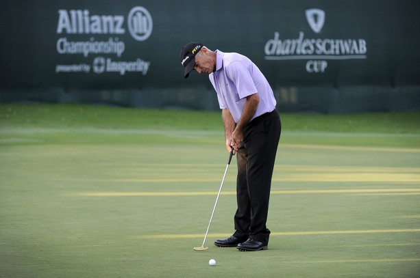 BOCA RATON, FL - FEBRUARY 11: Corey Pavin hits a putt on the 18th green after his putt during the second round of the Allianz Championship at The Old Course at Broken Sound on February 11, 2012 in Boca Raton, Florida.