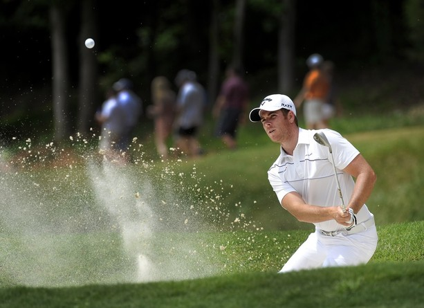 <p>GREER, SC - MAY 19: Luke List his from a bunker on the fifth hole during the third round of the BMW Charity Pro-Am presented by SYNNEX Corporation at the Thornblade Club on May 19, 2012 in Greer, South Carolina.</p>