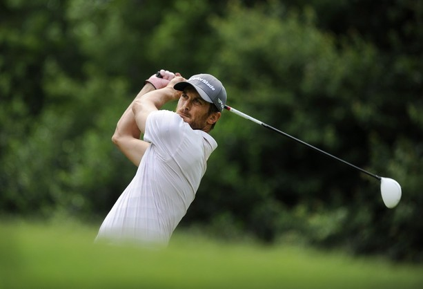 GREER, SC - MAY 19: Actor Oliver Hudson from Rules of Engagement hits a drive on the 16th hole during the third round of the BMW Charity Pro-Am presented by SYNNEX Corporation at the Thornblade Club on May 19, 2012 in Greer, South Carolina.
