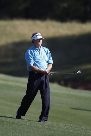BILOXI, MS - MARCH 24: Bob Gilder hits a shot from the fairway during the continuation of the first round of the Mississippi Gulf Resort Classic held at Fallen Oak Golf Club on March 24, 2012 in Biloxi, Mississippi.