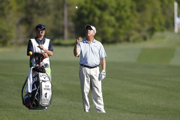 BILOXI, MS - MARCH 24:  Olin Browne prepares to hit a shot from the fairway during the continuation of the first round of the Mississippi Gulf Resort Classic held at Fallen Oak Golf Club on March 24, 2012 in Biloxi, Mississippi.