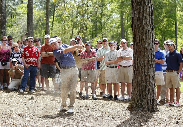 BILOXI, MS - MARCH 25: Jeff Sluman hits his second shot on the 13th hole from the trees during the final round of the Mississippi Gulf Resort Classic held at Fallen Oak Golf Club on March 25, 2012 in Biloxi, Mississippi.
