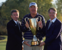 28 Oct 2001:  PGA Tour Commissioner Tim Finchem, Allen Doyle and Charles Schwab pose with the Charles Schwab Cup after the Senior Tour Championship at Gaillardia Golf and Country Club in Oklahoma City, Oklahoma. Mandatory Credit:  Scott Halleran /Allsport