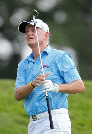 LAKE ORION, MI - JULY 15: Roger Chapman of England watches his second shot on the ninth hole during the final round of the 2012 Senior United States Open at Indianwood Golf and Country Club on July 15, 2012 in Lake Orion, Michigan.