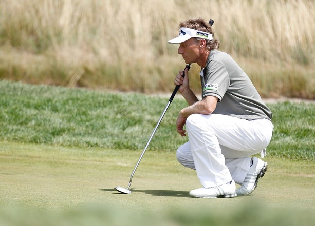 LAKE ORION, MI - JULY 15: Bernhard Langer of Germany reads a putt on the fourth hole during the final round of the 2012 Senior United States Open at Indianwood Golf and Country Club on July 15, 2012 in Lake Orion, Michigan.