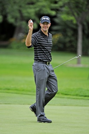 SANDY, UT - JULY 15: Doug LaBelle II waves his golf ball as he exits the third hole during the final round of the Utah Championship Presented by Utah Sports Commission at Willow Creek Country Club on July 15, 2012 in Sandy, Utah.