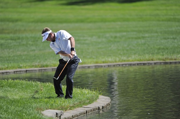 ENDICOTT, NY - AUGUST 19:  Willie Wood hits his third shot on the 4th hole after hitting his tee shot into the water during the final round of the Dick's Sporting Goods Open at En-Joie Golf Course on August 19, 2012 in Endicott, New York.