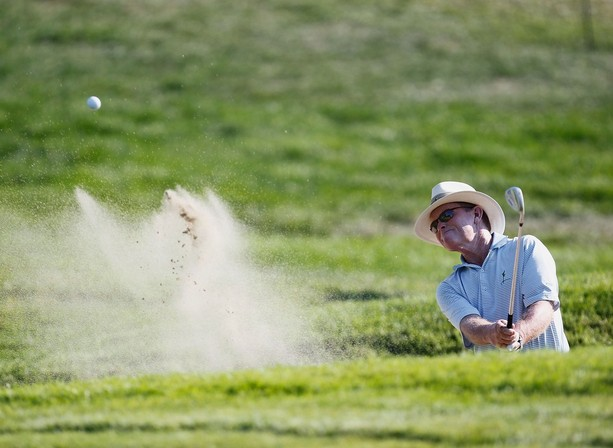 LAKE ORION, MI - JULY 13: Tom Kite hits from a green side sand trap on the ninth hole during the second round of the 2012 Senior United States Open at Indianwood Golf and Country Club on July 13, 2012 in Lake Orion, Michigan.