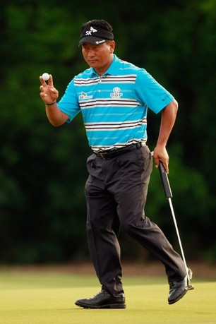 AVONDALE, LA - APRIL 27:  K.J. Choi reacts after making a putt on the 10th hole during the second round of the Zurich Classic at TPC Louisiana on April 27, 2012 in Avondale, Louisiana.