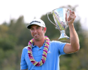 KAPALUA, HI - JANUARY 08:  Dustin Johnson celebrates with the Hyundai Tournament of Champions Cup after winning following the final round at the Plantation Course on January 8, 2013 in Kapalua, Hawaii.  (Photo by Christian Petersen/Getty Images)