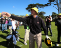 PEBBLE BEACH, CA - FEBRUARY 09:  San Francisco 49ers head coach Jim Harbaugh passes caps to fans on the 17th hole during the third round of the AT&T Pebble Beach National Pro-Am at Pebble Beach Golf Links on February 9, 2013 in Pebble Beach, California.  (Photo by Jed Jacobsohn/Getty Images)