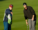 PEBBLE BEACH, CA - FEBRUARY 09:  Tennis great Andy Roddick lines up a putt on the first hole with his caddie during the third round of the AT&T Pebble Beach National Pro-Am at Pebble Beach Golf Links on February 9, 2013 in Pebble Beach, California.  (Photo by Ezra Shaw/Getty Images)